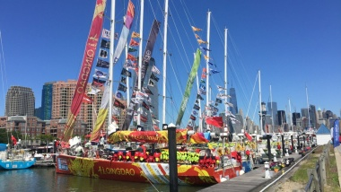 Clipper boats flying their banners and flags